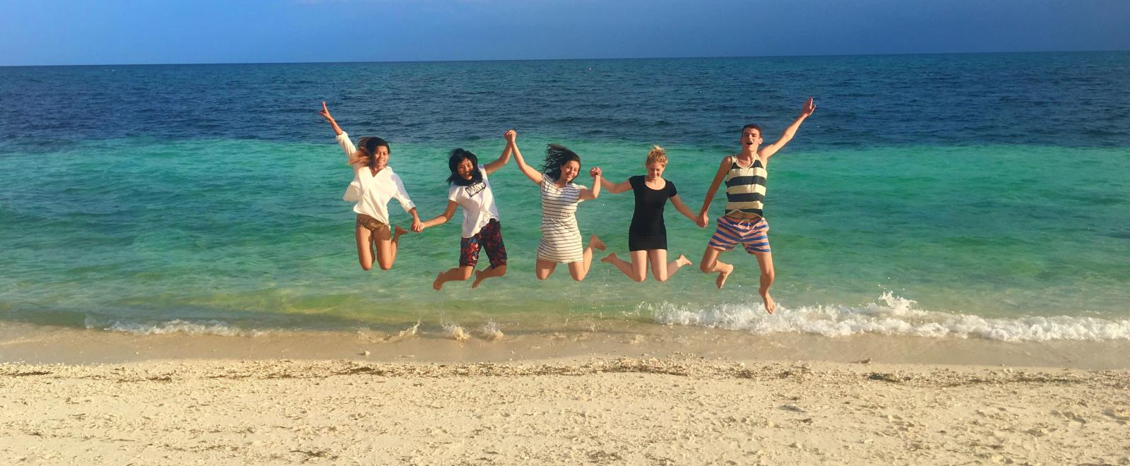 Projects Abroad volunteers having fun on a beach in the Philippines.